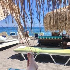 A day on the black sand beach of Perivolos